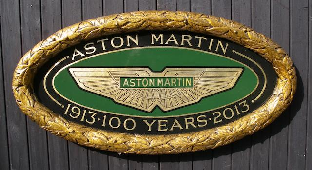 A hand-painted Aston Martin Centenary display roundel,