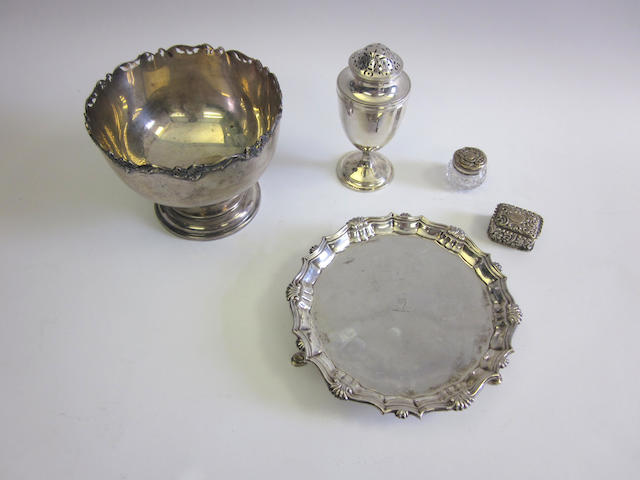 A George II  silver waiter by Hugh Mills, London 1750; together with a silver bowl, a sugar caster, a silver box and a silver-mounted glass pot  (5)