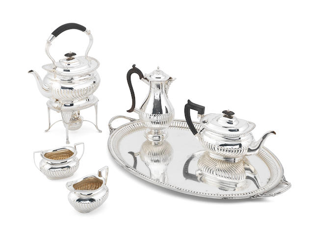 A matched silver five-piece tea service together with a silver two handle tray by William & George Sissons, Sheffield and London 1913, the hot water pot and tray, by William Hutton & Sons Ltd, Sheffield 1912 / 13  (6)
