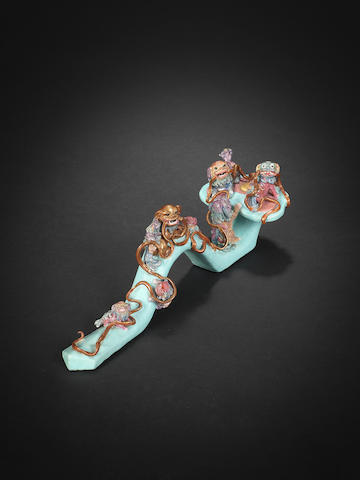 A very rare famille rose 'Buddhist Lions' ruyi sceptre Daoguang 30cm (11¾in) long