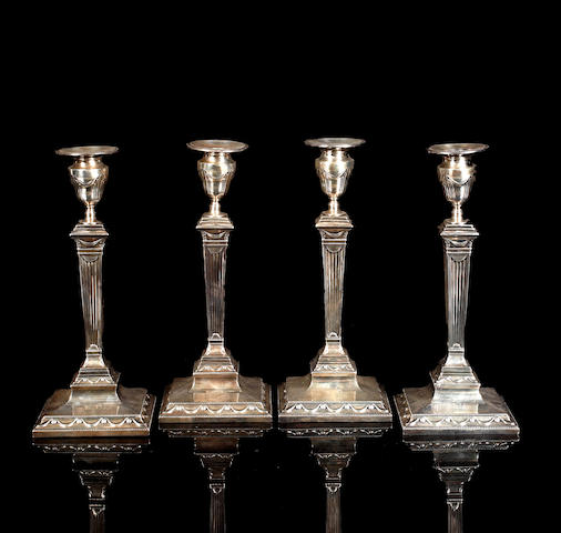A set of 4 Tiffany silver table candlesticks