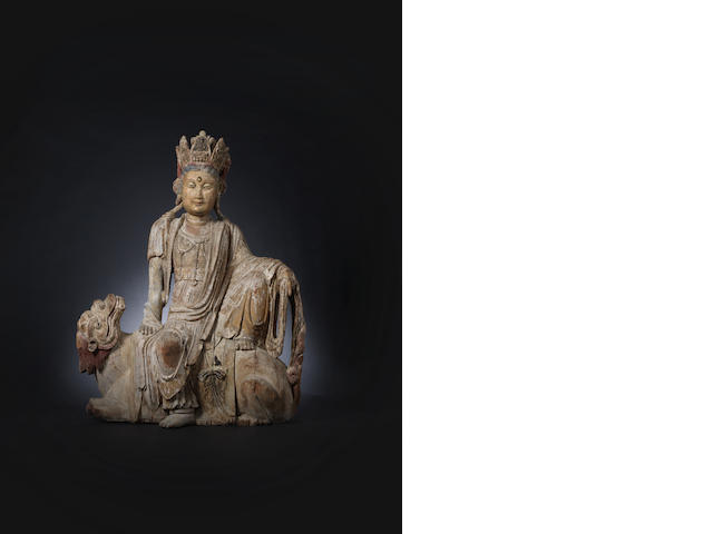 A carved wooden figure of Guanyin Probably 15th century