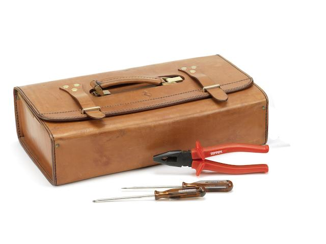 A leather-cased Ferrari 348/355 tool kit, by Schedoni of Modena,