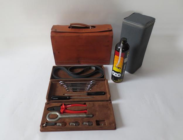 A leather-cased Ferrari 308/348/355 tool kit, by Schedoni of Modena,