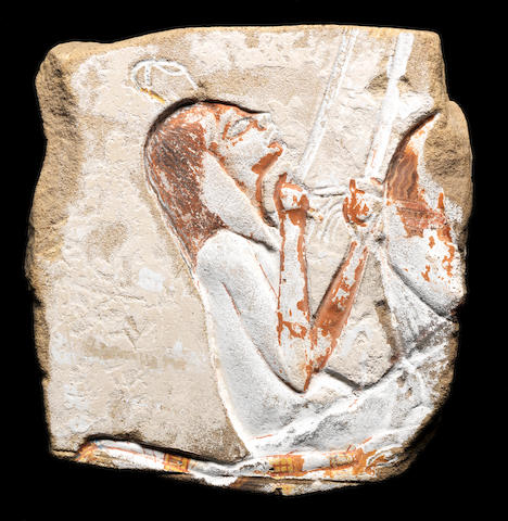 An Egyptian sandstone relief fragment