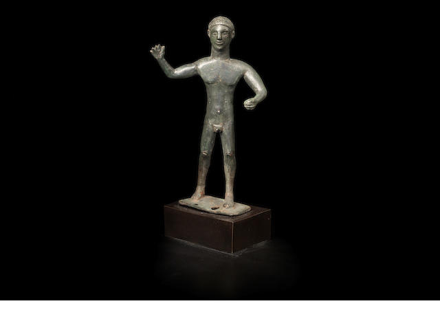 An Etruscan bronze male figure
