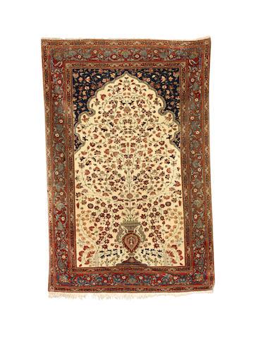 A Mohtashem Kashan prayer rug, Central Persia, circa 1890, 207cm x 138cm