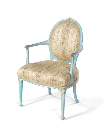 A George III polychrome decorated and parcel gilt open armchair attributed to Thomas Chippendale Snr or Jnr
