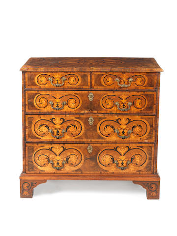 A William and Mary walnut oyster veneered, sycamore and ebony marquetry chest
