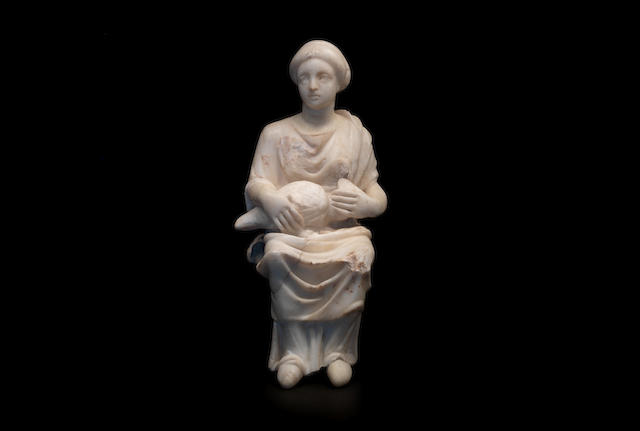 A Late Roman marble figure of a girl holding a goose