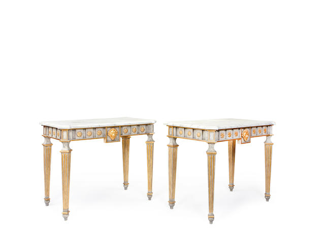 A pair of North Italian late 18th century style painted and parcel gilt pier tables