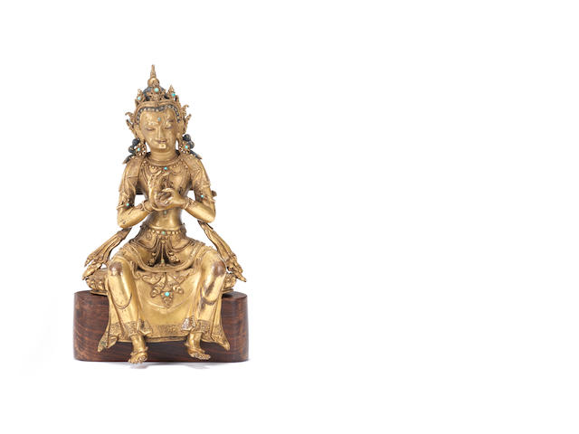 A rare gilt-bronze figure of Maitreya 16th/17th century