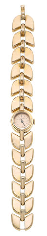 A gold wristwatch, by Boucheron,