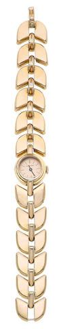 A gold wristwatch, by Boucheron,