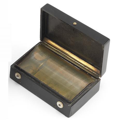 A musical bois durci snuff box, Swiss, mid 19th century,