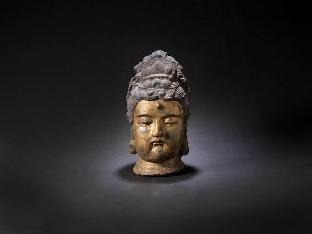 A massive gilt and lacquered iron head of Guanyin Ming Dynasty