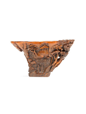 A very rare rhinoceros horn 'scholars in landscape' libation cup 17th/18th century