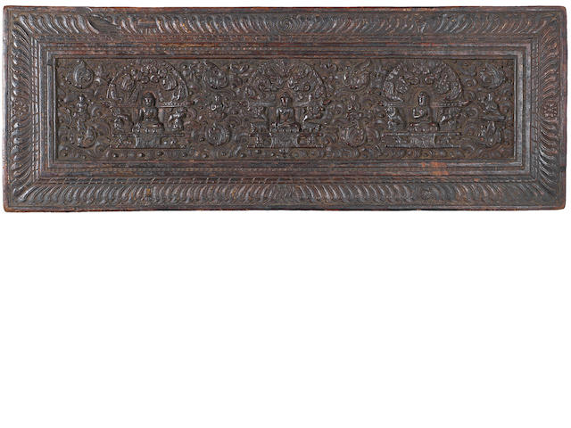 A Tibetan lacquered-wood rectangular carved panel Probably 15th century