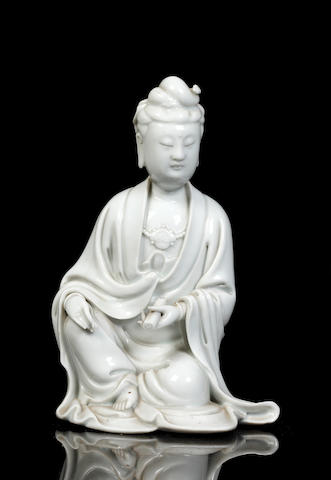 A Chinese blanc-de-chine figure of a seated Guanyin