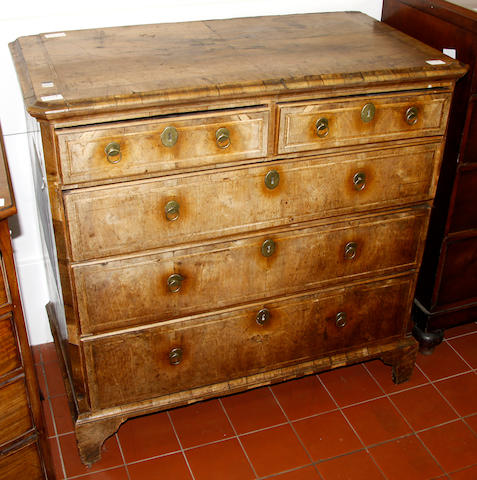 An 18th century walnut veneered chest