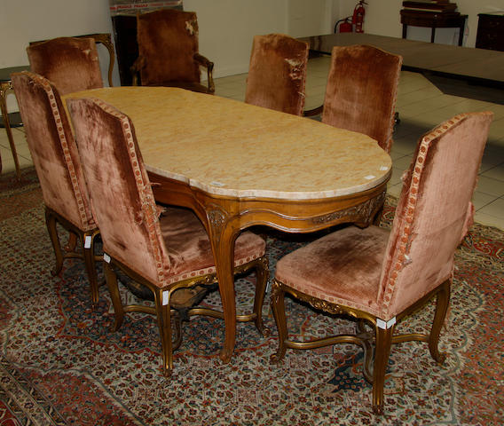 An early/mid 20th century dining suite in the French taste comprising: