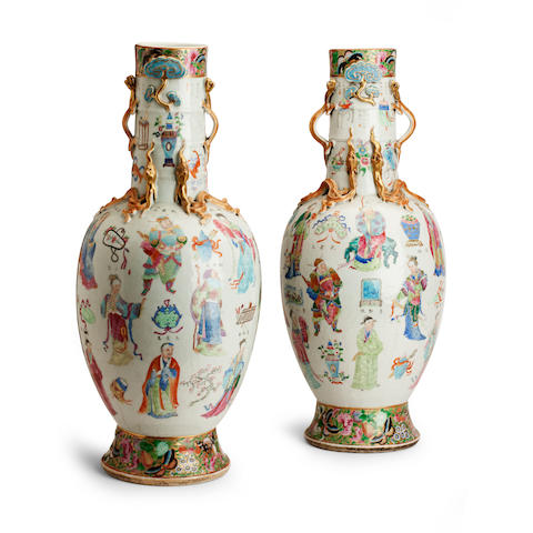 A pair of large and impressive famille rose 'Table of the Peerless Heroes' vases 19th century