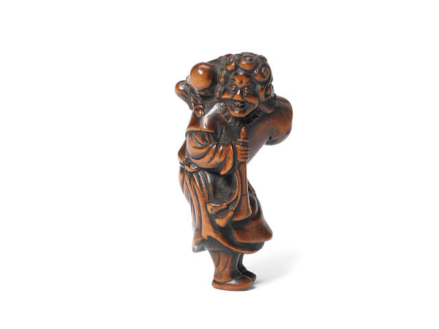 A wood netsuke of a Dutchman  18th century