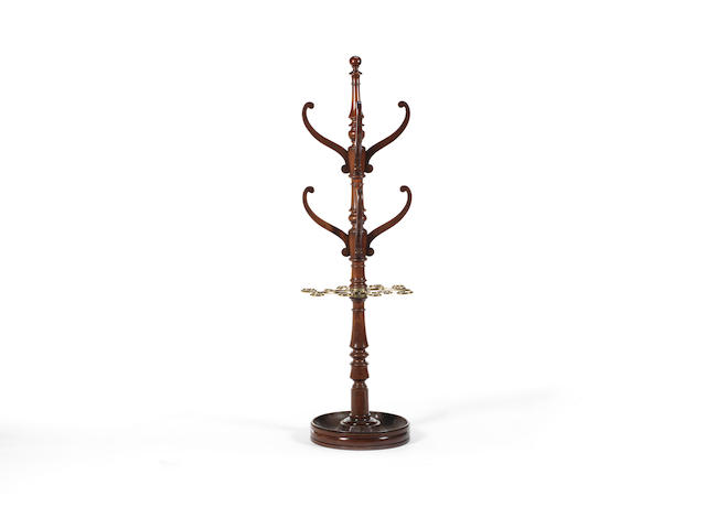 A George IV mahogany and brass coat stand in the manner of Gillows