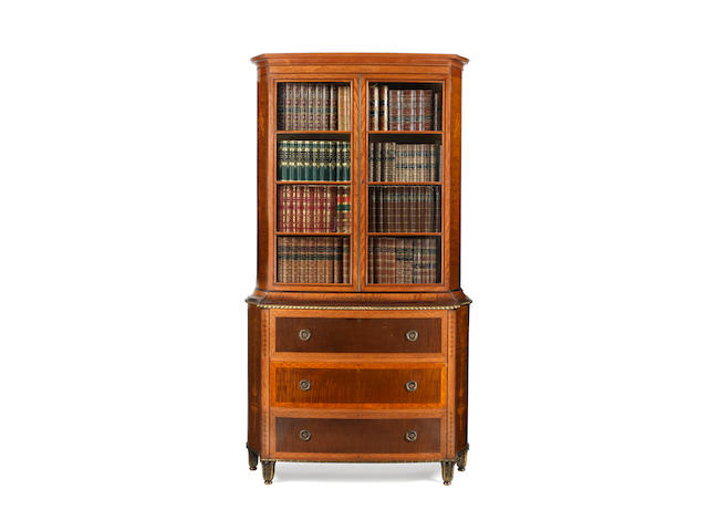 A late Victorian Irish sycamore, satinwood and rosewood crossbanded and harewood marquetry bookcase by Hicks of Dublin