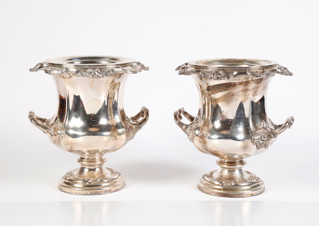 A pair of silver plated wine coolers of campana shape
