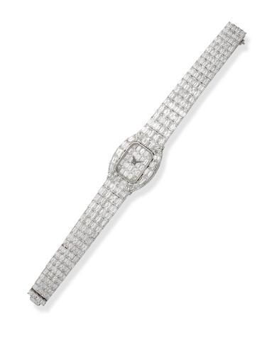 A lady's diamond bracelet watch, by David Morris