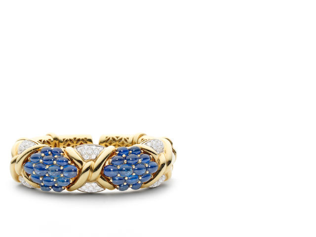 An 18 carat yellow gold, sapphire and diamond bangle, by David Morris