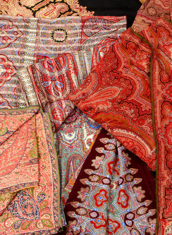 A collection of nine 19th and early 20th century Indian and European woven and printed Paisley shawls
