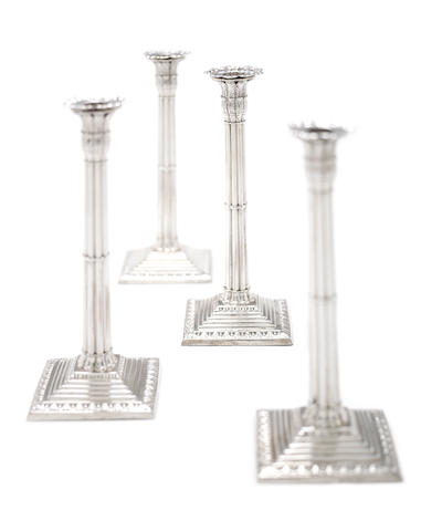 A set of four George III silver candlesticks by Ebenezer Coker, London 1766 - 67,  (4)