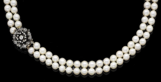 A two-strand cultured pearl necklace with a diamond-set clasp