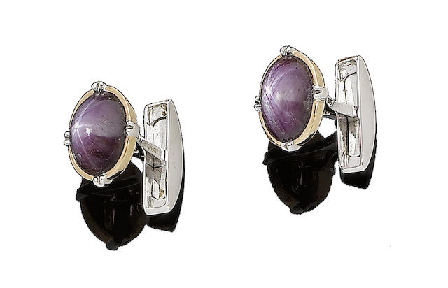 A pair of star ruby cufflinks, by Hirsh
