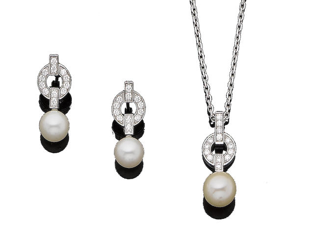 A 'Himalia' cultured pearl and diamond pendant necklace and earring suite, by Cartier (2)