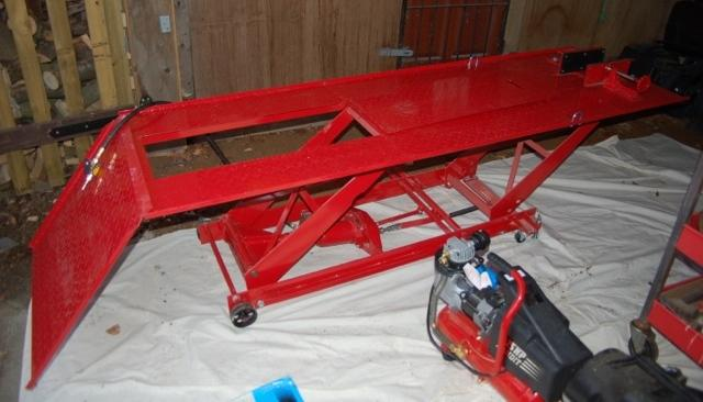 A motorcycle workshop ramp and other tools and equipment,