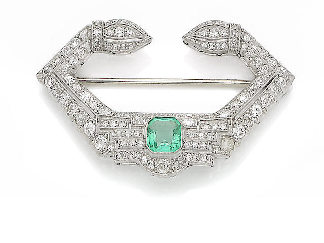 An art deco emerald and diamond brooch,