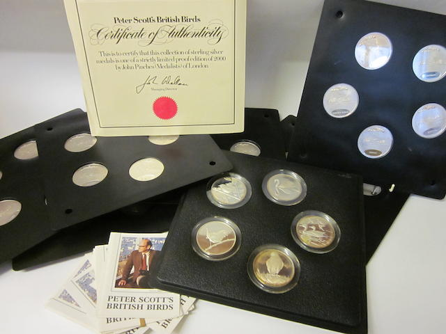 Peter Scott: A cased set of thirty-five silver proof medals by John Pinches,