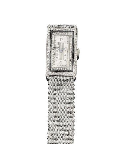 An art deco onyx, seed pearl and diamond wristwatch,