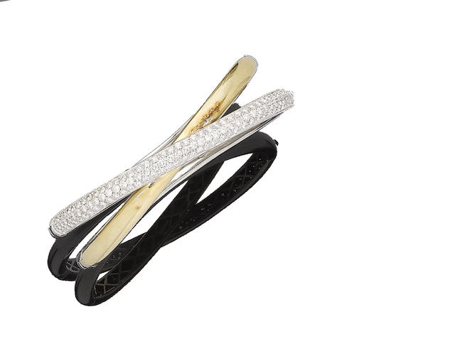 A gold and diamond-set hinged bangle