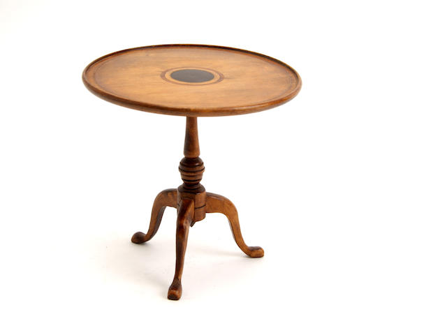 A miniature tripod table in the Georgian style