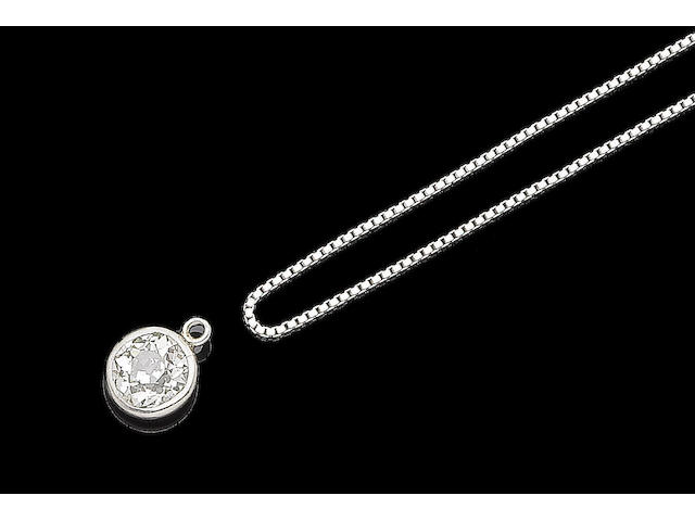 A diamond single-stone pendant and necklace (2)