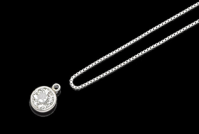 A diamond single-stone pendant and necklace (2)