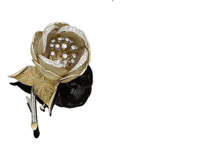 A diamond-set flower brooch,