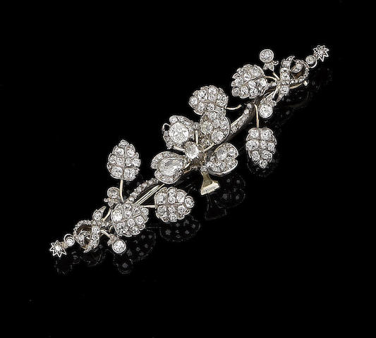 A diamond brooch, (2)