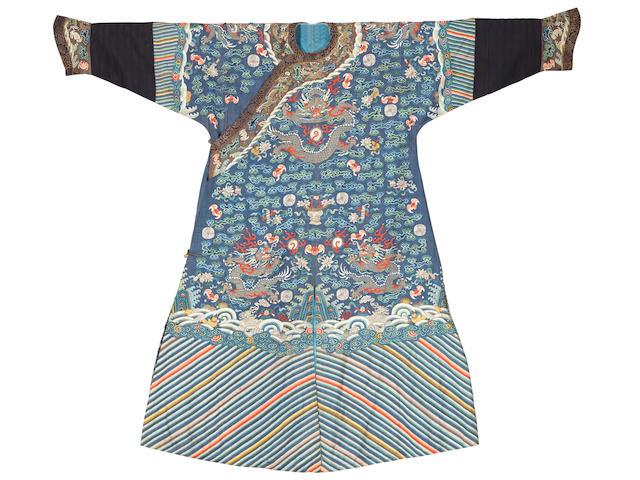 A kesi silk blue-ground 'nine-dragon' robe Late Qing Dynasty