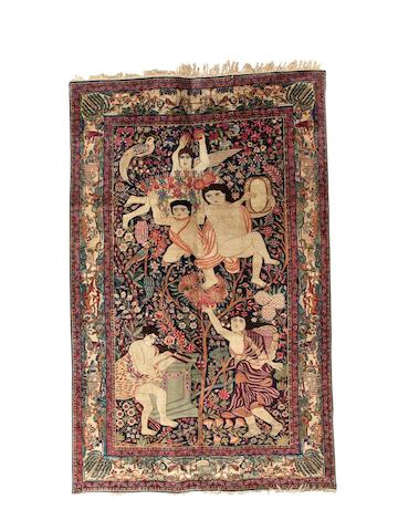 A Kirman carpet, South East Persia, circa 1910, 352cm x 255cm