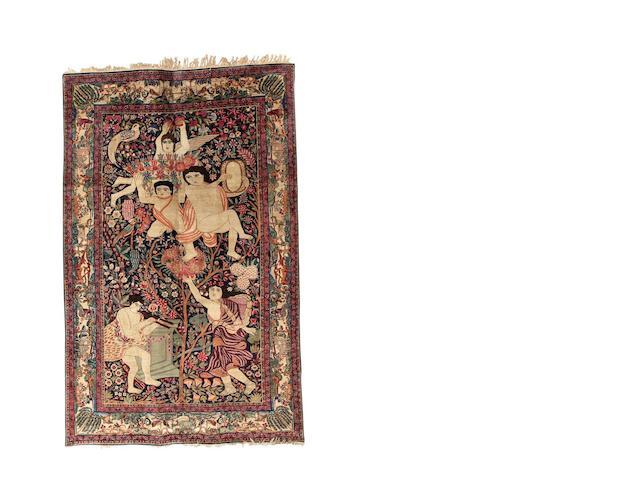 A Kirman carpet, South East Persia, circa 1910, 352cm x 255cm